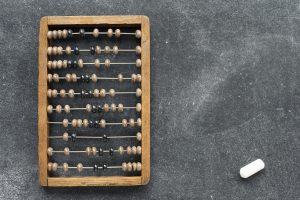 vintage wooden abacus with chalk piece on the blackboard